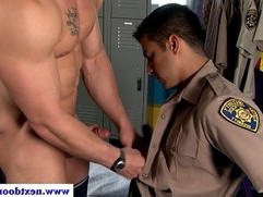 Security guard sucks off muscled dude