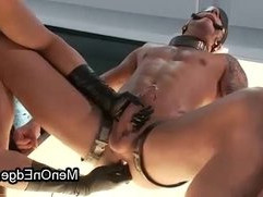 Shackled gay cock slapped while standing and ass wired on neon table